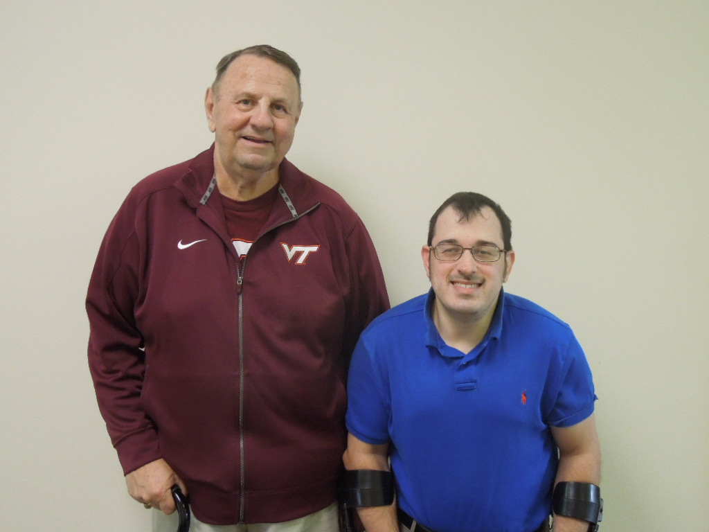 A happy consumer stands beside the Center's Independent Living Coordinator, Matt Shelor