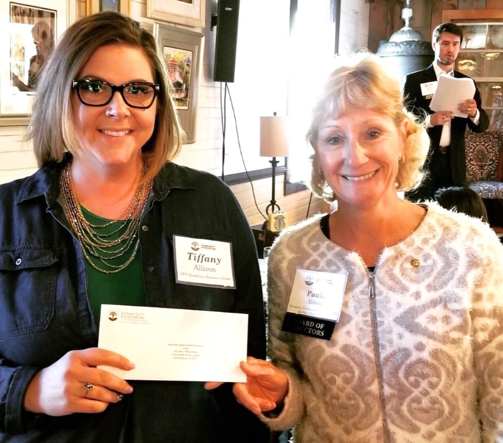 NRV DRC's Community Advocate, Tiffany Allison, accepts the grant awarded from Board of Directors, Paula Alston, with the Community Foundation of the NRV.